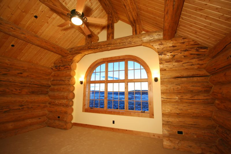 Bedroom with log arch