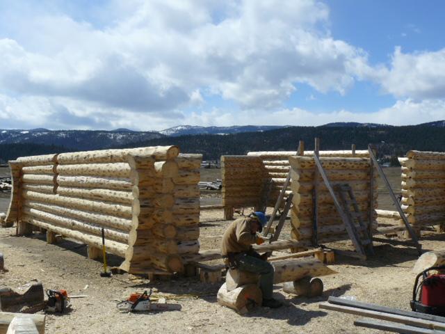 Lyle chiseling a log