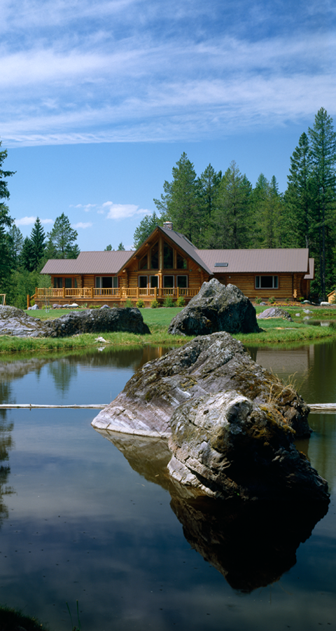 a log cabin by a lake